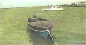 Wooden runabout at anchor