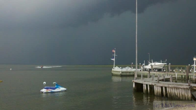A jet skier trying to get back to shore before a storm hits
