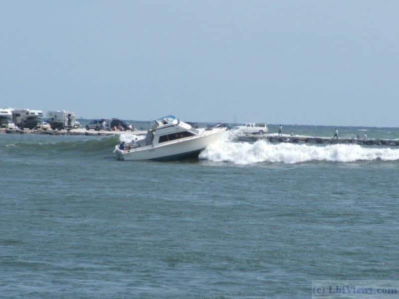 Boat heading out through the breakers in Barnegat Inlet