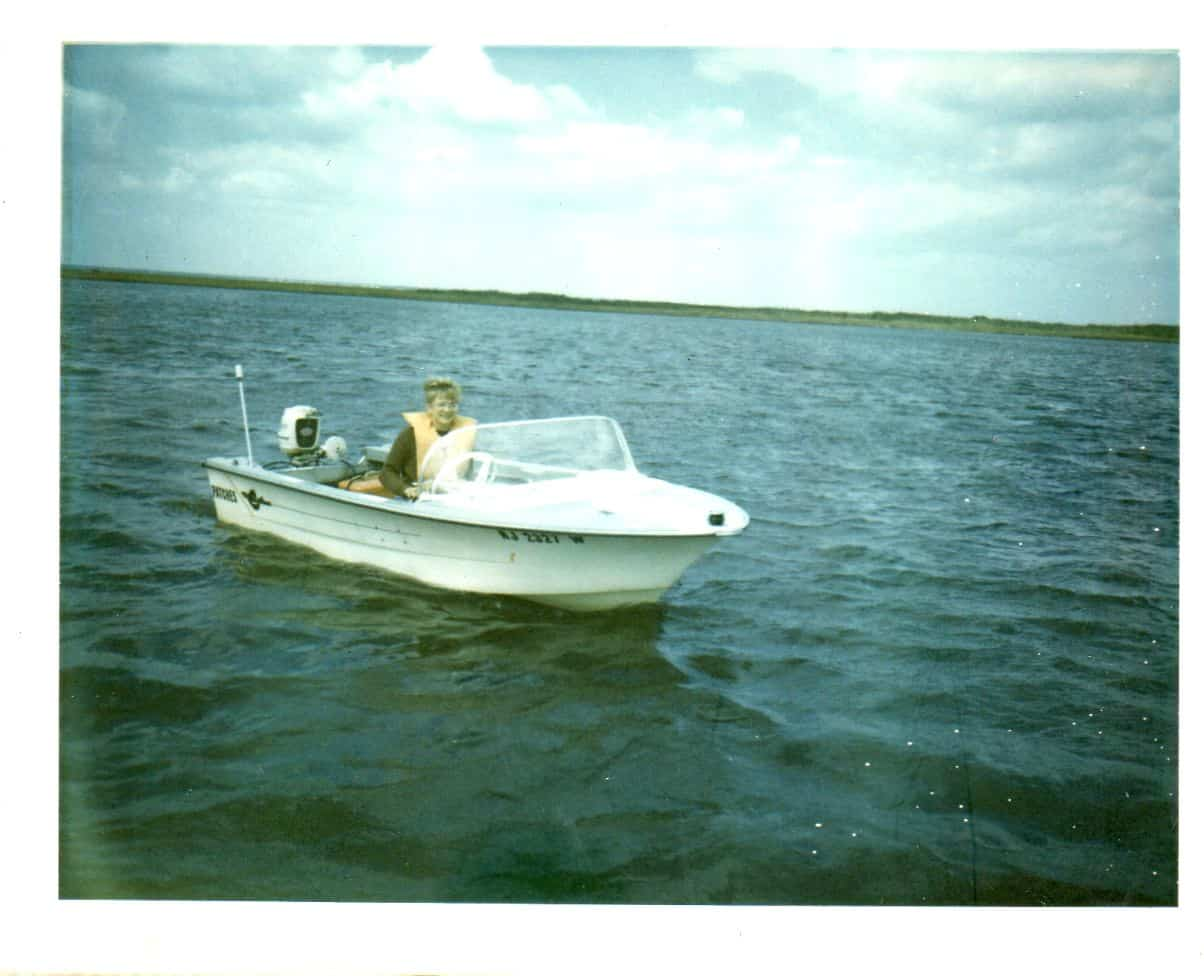 1970's 14' Crestliner with a 22HP white Mercury Outboard.