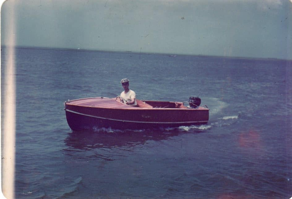 A color photo of a 14' boat most likely  in the late 1940's
