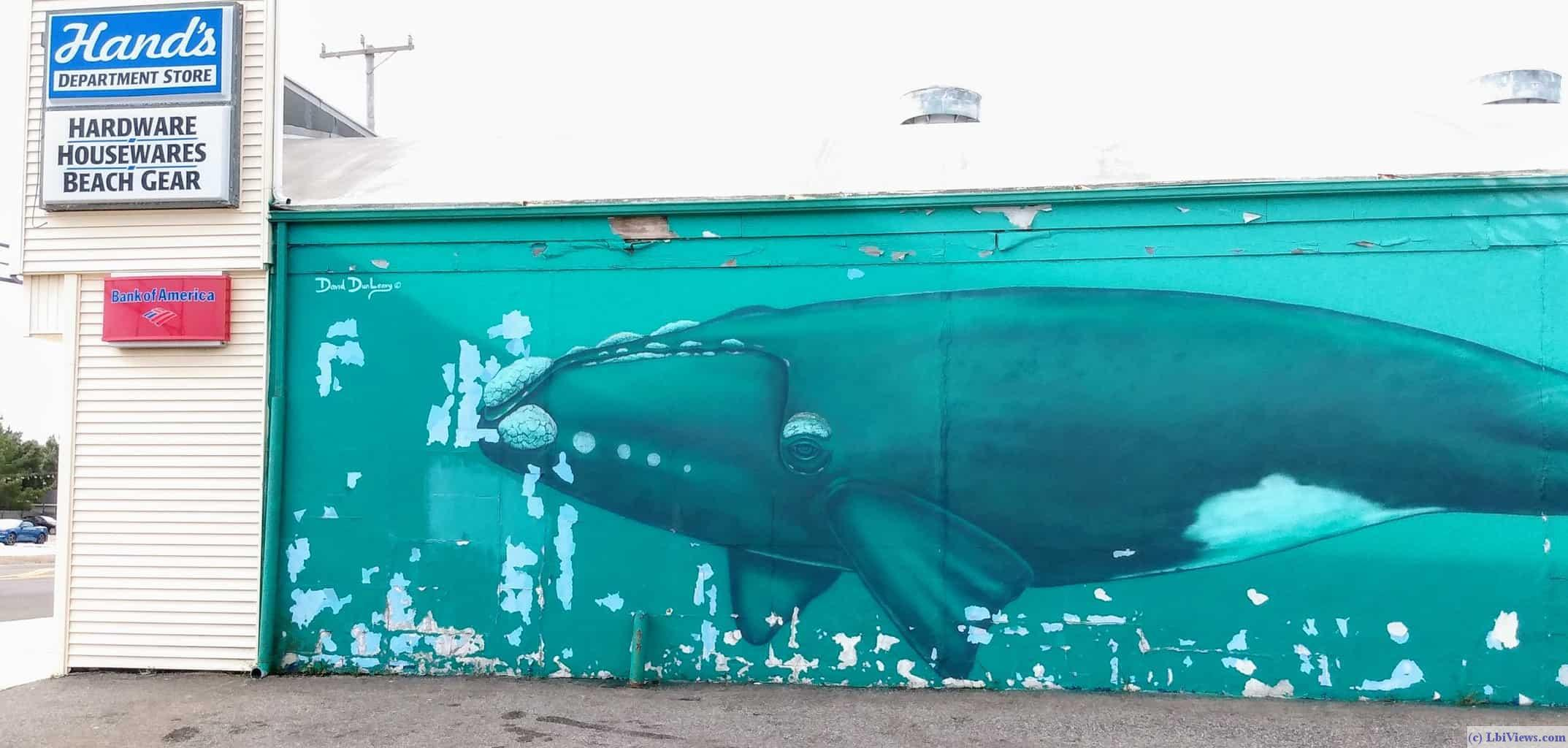 Mural of two right whales on the north side of Hands in North Beach Haven.