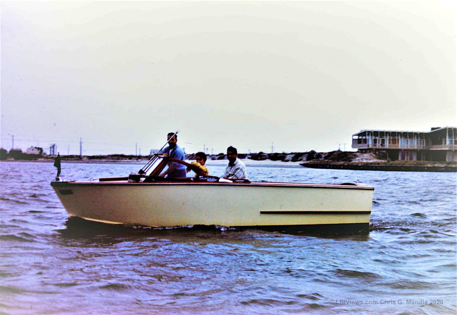 Old wooden inboard runabout in front of the Shapiro Mansion - Long Beach Island - 1950's