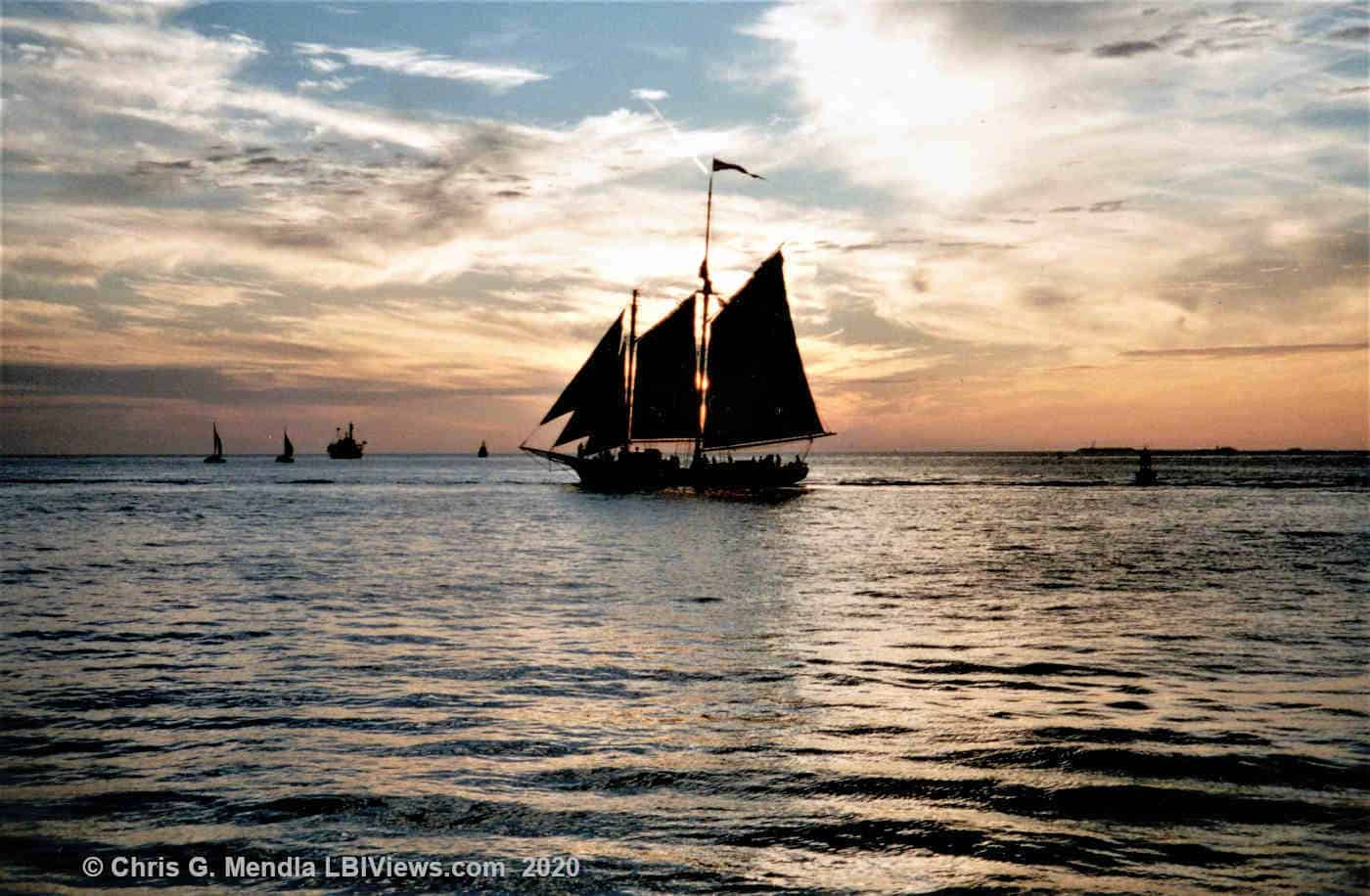 The A. J. Meerwald under sail at sunset off Beach Haven 2003